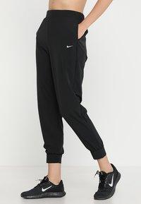 Nike Performance - Pantalon de survêtement - black/white - 0