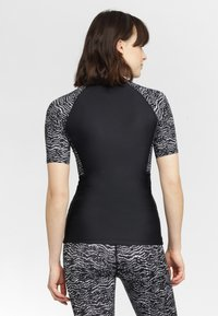 O'Neill - MIX SKINS - Rash vest - black