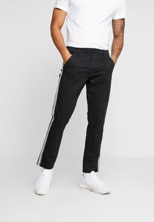 RETRO - Trousers - black