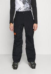 Helly Hansen - SOGN - Spodnie narciarskie - black - 0