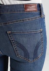 Hollister Co. - STRECH HIGH RISE SUPER SKINNY  - Jeans Skinny Fit - medium wash - 4