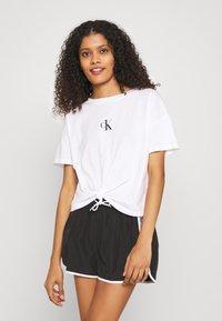 Calvin Klein Swimwear - CORE LOGO TAPE - Bikini bottoms - black - 0