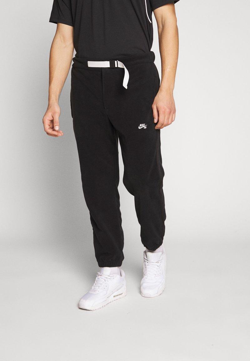 Nike SB - NOVELTY PANT - Spodnie treningowe - black/(sail)
