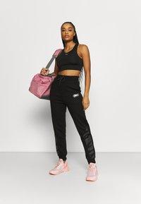 Puma - REBEL HIGH WAIST PANTS  - Pantalones deportivos - puma black untamted - 1