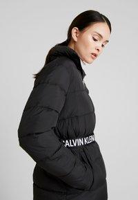 Calvin Klein Jeans - LONG PUFFER WITH WAIST BELT - Veste d'hiver - black - 3