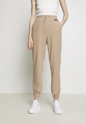 ARINNA PANTS - Tracksuit bottoms - sand