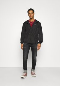 Tommy Jeans - PACKABLE  - Outdoorjacka - black - 1