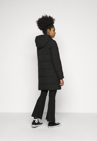 ONLY Petite - ONLDOLLY LONG PUFFER COAT - Vinterkåpe / -frakk - black - 2