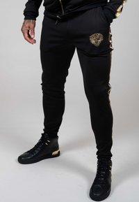 Ed Hardy - LOVE ED TRACK PANT - Tracksuit bottoms - black - 0