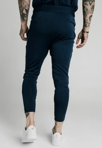 SIKSILK - AGILITY TRACK PANTS - Tracksuit bottoms - navy - 2