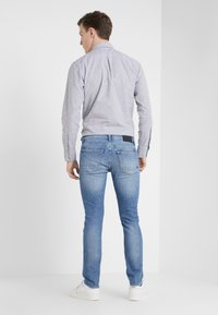 BOSS - DELAWARE  - Jeans slim fit - light blue denim