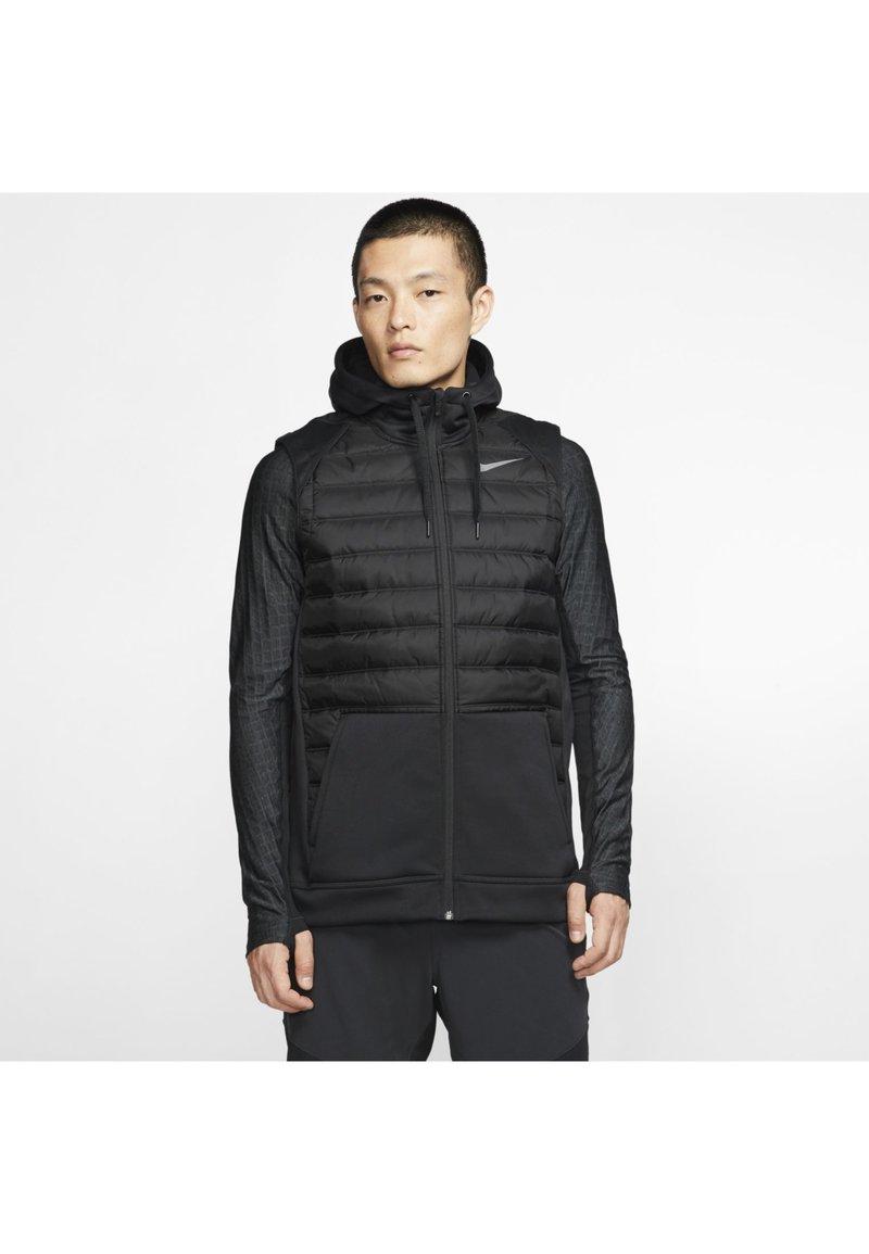 Nike Performance - THERMA - Waistcoat - black/dark grey
