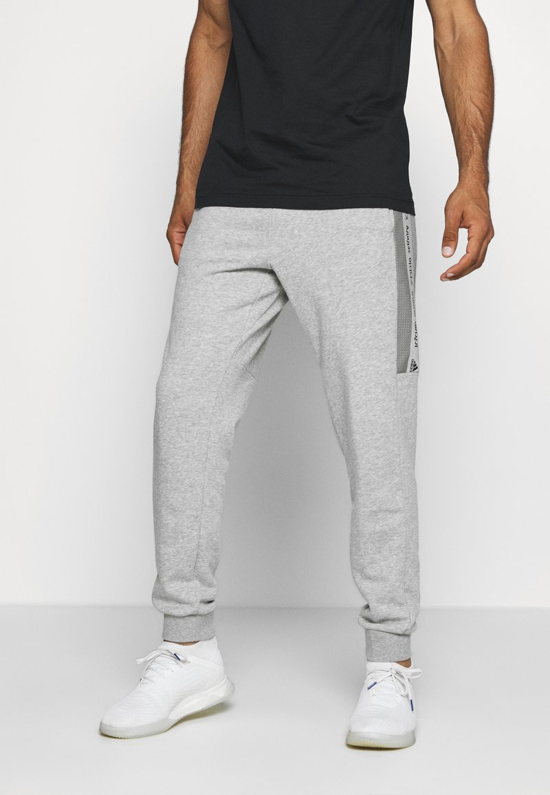 adidas Performance - Tracksuit bottoms - medium grey heather