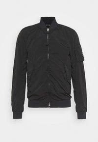 C.P. Company - OUTERWEAR SHORT JACKET - Summer jacket - black - 4