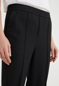 Filippa K - FIONA PEG - Trousers - black - 4