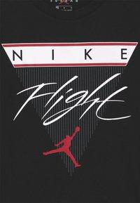Jordan - FLIGHT HISTORY TEE UNISEX - T-shirt med print - black - 2
