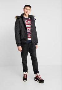 Tommy Jeans - TECH JACKET - Veste d'hiver - black - 1