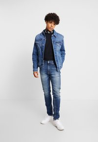 Calvin Klein Jeans - TAPER - Jeans Tapered Fit - blue - 1