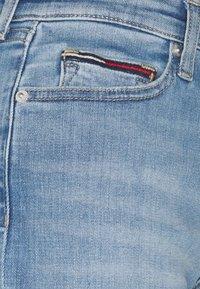 Tommy Jeans - MID RISE - Denim shorts - tess light blue - 7