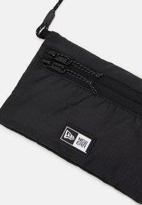 New Era - SACOCHE MINI SIDE BAG - Across body bag - black - 3