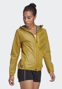 adidas Performance - TERREX AGRAVIC RAIN JACKET - Waterproof jacket - gold - 4