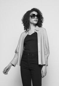 rag & bone - NINA HIGH RISE ANKLE FLARE - Flared Jeans - black - 3