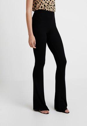 FLARE - Kalhoty - black