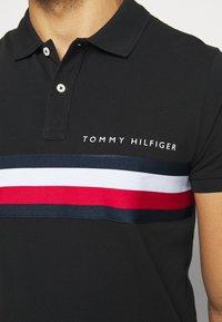 Tommy Hilfiger - GLOBAL CHEST TAPE SLIM - Polo shirt - black - 5