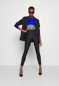 Versace Jeans Couture - PANTS - Leggings - Trousers - black - 5