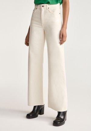 Flared Jeans - cream