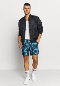 Nike Sportswear - FLOW  - Shorts - cerulean/thunderstorm/white - 1