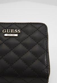 Guess - KAMRYN SMALL ZIP AROUND - Wallet - black - 2