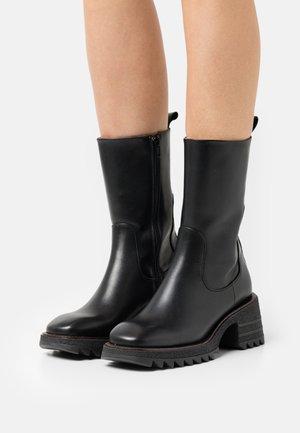 FIONA - Platform ankle boots - black