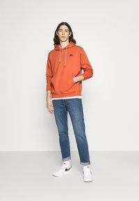 Nike Sportswear - HOODIE - Hoodie - light sienna - 1