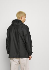 Rains - ULTRALIGHT JACKET UNISEX - Waterproof jacket - black - 2
