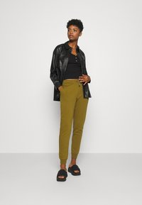 Nike Sportswear - Tracksuit bottoms - olive flak/white - 1