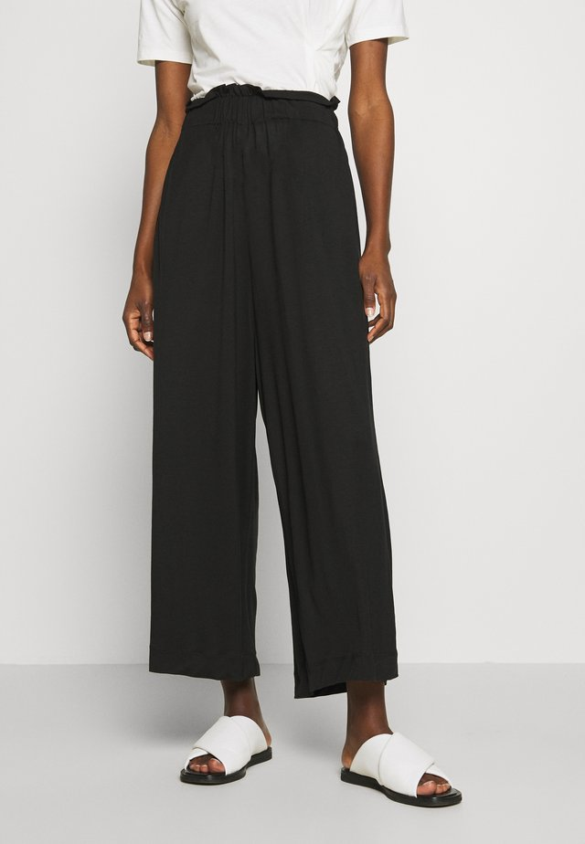 COME TOGETHER PANTS - Trousers - black