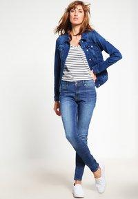 edc by Esprit - HIGH SKIN PANTS DENIM - Slim fit jeans - blue denim - 1
