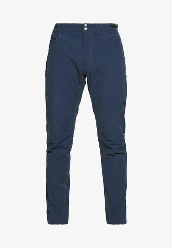 SVALBARD PANTS - Trousers - indigo night