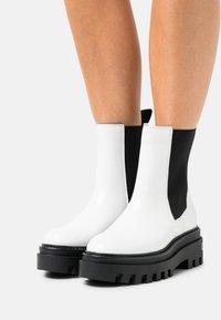 Calvin Klein Jeans - FLATFORM MID CHELSEA BOOT - Platform ankle boots - bright white - 0