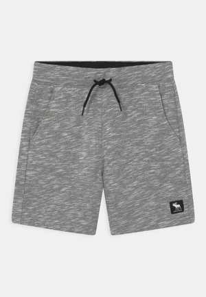 ABOVE THE KNEE - Tracksuit bottoms - grey