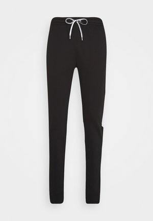 LEGACY MODULAR BLOCKING CUFF PANTS - Tracksuit bottoms - black