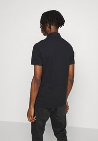 Hollister Co. - HERITAGE SOLID NEUTRALS - Polo shirt - black - 2