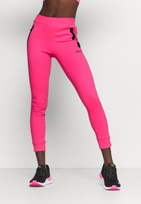 Ellesse - CANA - Tracksuit bottoms - neon pink - 0