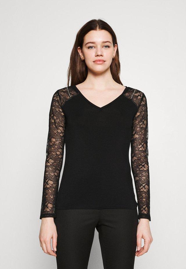 THEA - Pitkähihainen paita - black