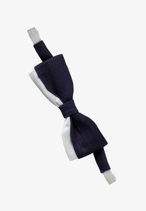 Bow tie - tipo