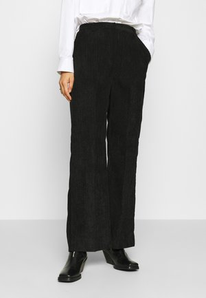 BOYAS NEW - Trousers - black