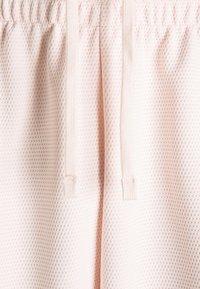 Nike SB - SUNDAY UNISEX - Tracksuit bottoms - orange pearl/coconut milk - 4