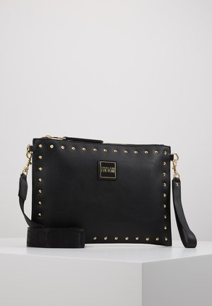 STUDDED POUCH ON STRAP - Pochette - black