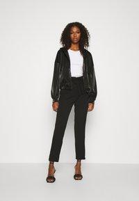 Vero Moda - VMSAGA STRING PANT - Trousers - black - 1